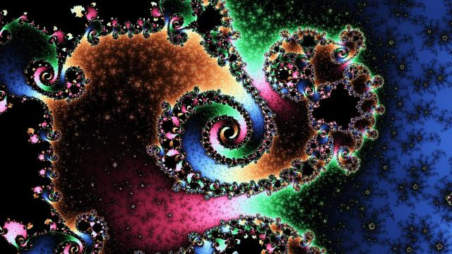 A colorful Mandelbrot image resembling a spiral galaxy.